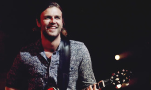 Joel Houston with Guitar